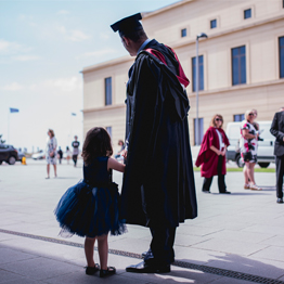 Man and child at graduation