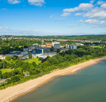 Aerial shot of 单公园校园 and the Beach in the glorious sunshine