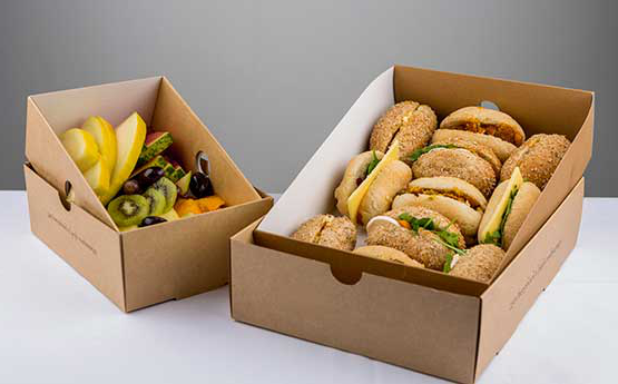A box of rolls and a box of fruit presented in lovely brown boxes