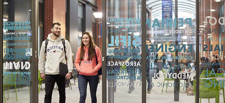 Students walking through a door in Engineering Central