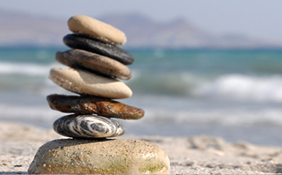 Image of stones balancing on a beach