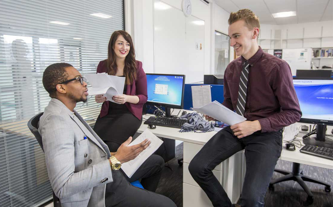 image of research students chatting and laughing