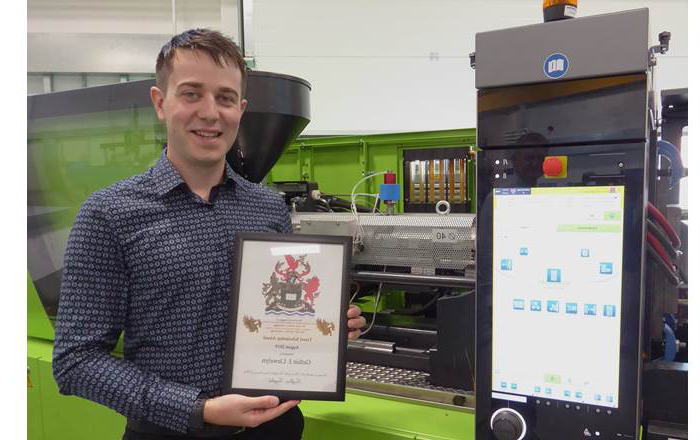 Gethin Llewelyn of Swansea University with his Livery Company award for his work to develop greener methods of making car parts