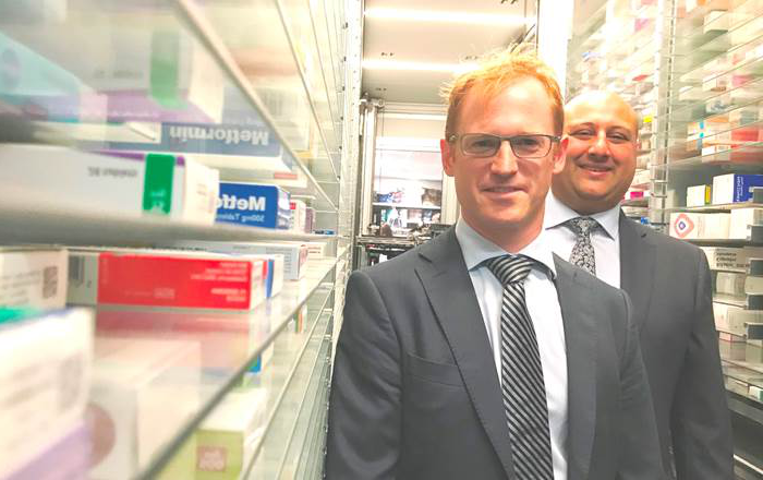 Swansea University's Head of Pharmacy Andrew Morris pictured with Dr Mo Nazemi at Evans Pharmacy's Ty Elli branch.