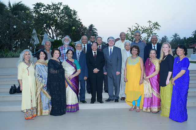 India alumni stood in an outdo要么 group photo