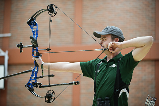 a person doing Archery