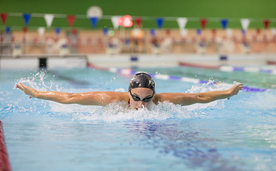 A photo of a swimmer going through the water at the Wales National Pool