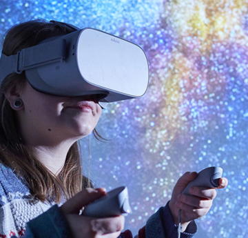 Student using virtual reality glasses to look through space