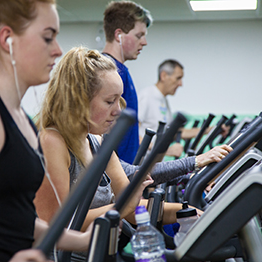 People running on treadmills at Swansea University gym.